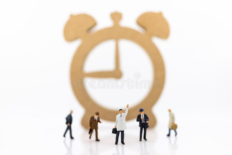 Miniature people : Businessmen and watches, use images for reporting work time per day, calculate salary of employee.  royalty free stock photo