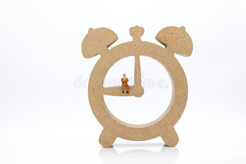 Miniature people : Businessmen and watches, use images for reporting work time per day, calculate salary of employee.  royalty free stock image