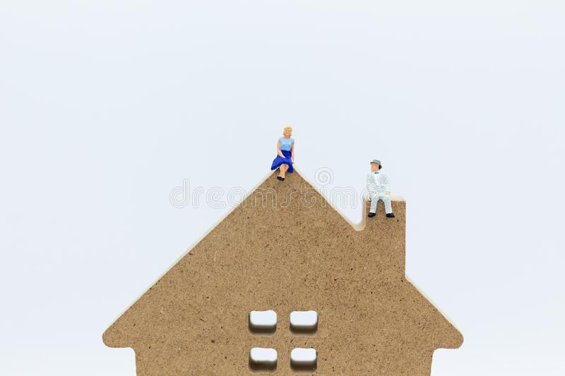 Miniature people :Buying a home loan in the future, Shelter, Long-term investment. Image use for business concept.  stock photos