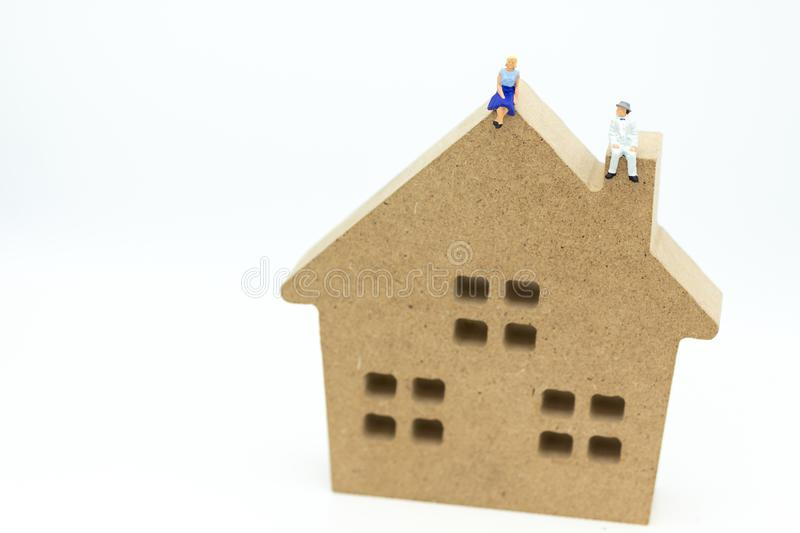 Miniature people :Buying a home loan in the future, Shelter, Long-term investment. Image use for business concept.  stock photography