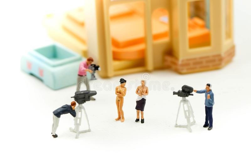 Miniature people : Cameraman and photographer trying to take a photo with beautiful nude topless breasts, Nude concept royalty free stock images