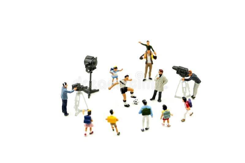 Miniature people : Cameramen, photographers and reporters interviewing football player with children,student. stock photo
