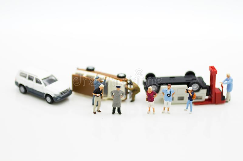 Miniature people: Car crash, Insurance business. Image use for not living with carelessness, danger on the road, carefully concept.  stock photos