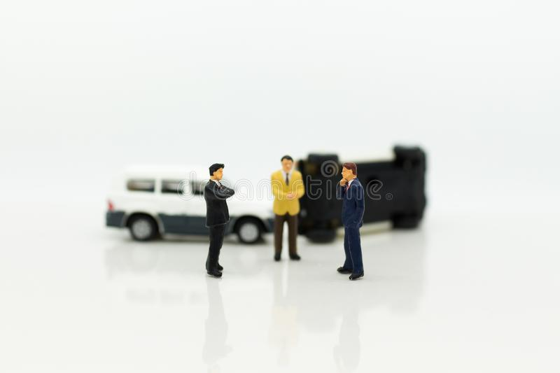 Miniature people: Car crash, Insurance business. Image use for not living with carelessness, danger on the road, carefully concept.  royalty free stock photo