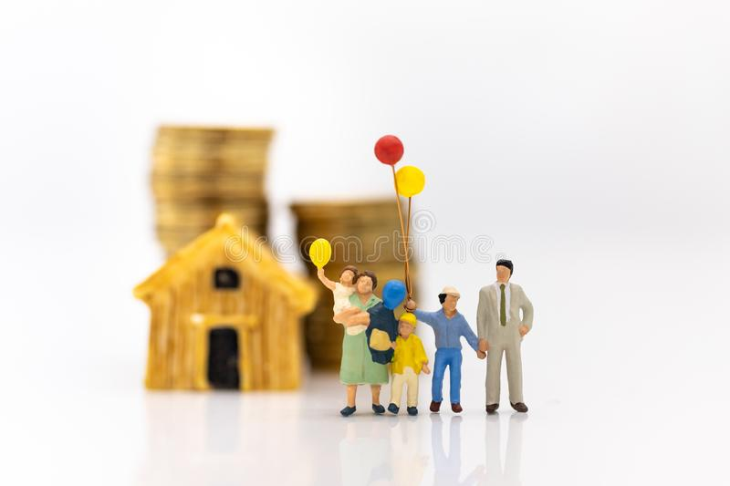 Miniature people: Children holding balloon with family at home . Image use for background International day of families concept royalty free stock photos