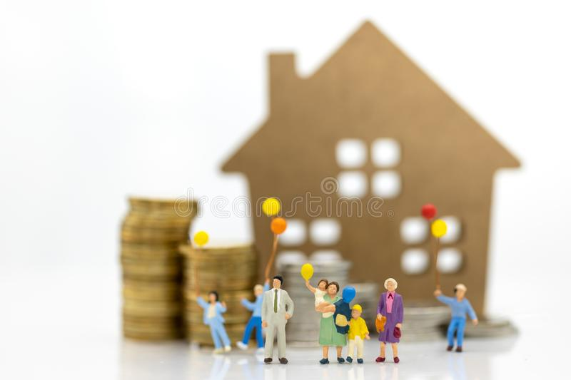 Miniature people: Children holding balloon with family at home . Image use for background International day of families concept stock images