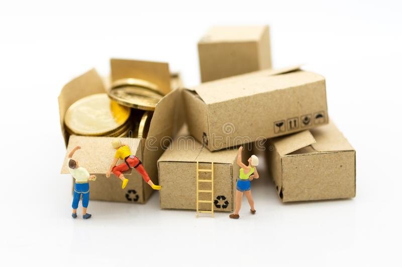Miniature people: Climbers are climbing box. Image use for business, industrial and logistic concept stock images