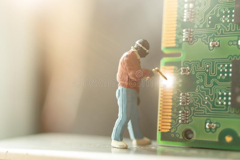 Miniature people : Computer repairman repair Computer hardware stock images