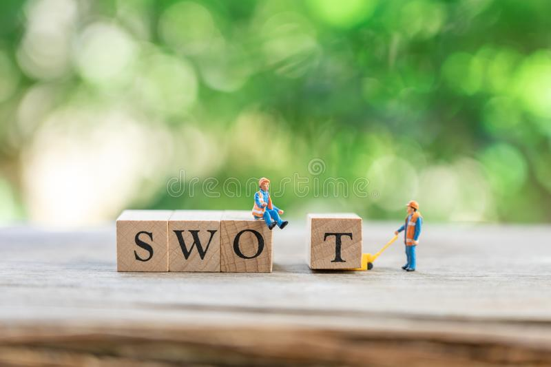Miniature people Construction worker with wood word team as background business and swot concept with copy space. Miniature people Construction worker with wood royalty free stock photography