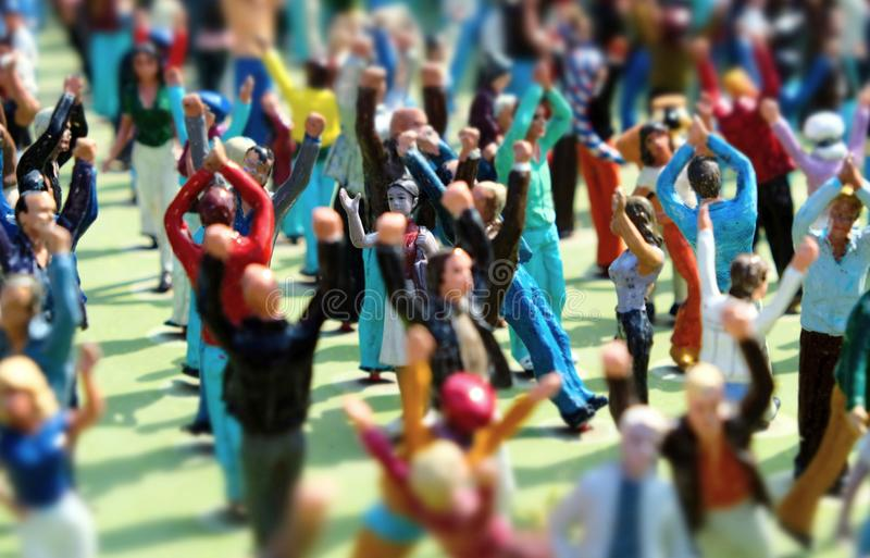 Miniature people dancing at a festival stock images