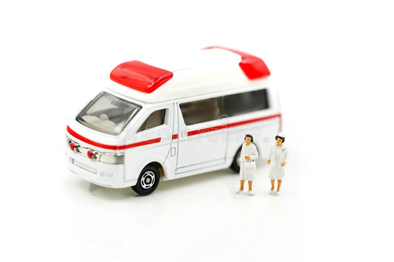 Miniature people : Doctor and Nurse emergency medical team with pills and Ambulance ,Health care, medical service, and insurance. Concept stock photography