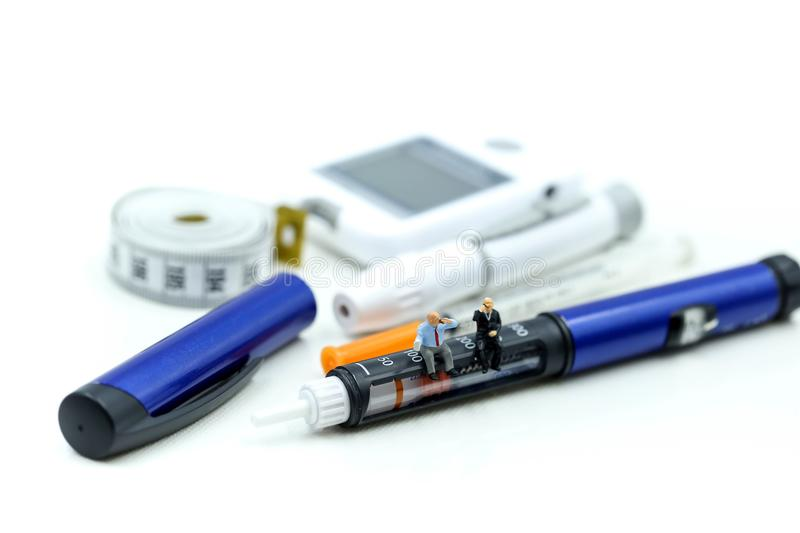 Miniature people : Doctor and Patient with Insulin pen ,Diabetes equipment ,glucose level blood test,Diabetes concept stock image