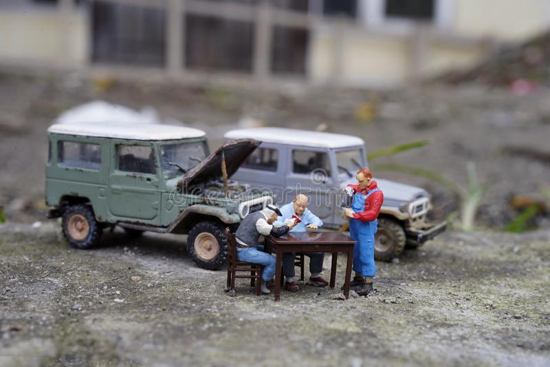 Miniature people of drinking tea on break time. Taking time for conversation and with hot beverage. Miniature, date, vehicle, tea, drink, morning, mug, cup stock image