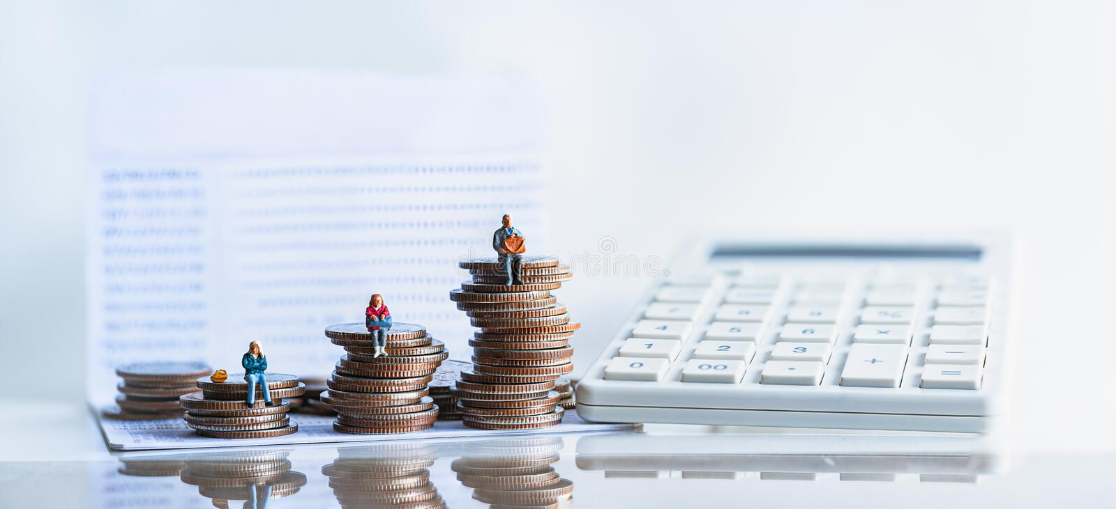 Elderly people sitting on coins stack. royalty free stock photo