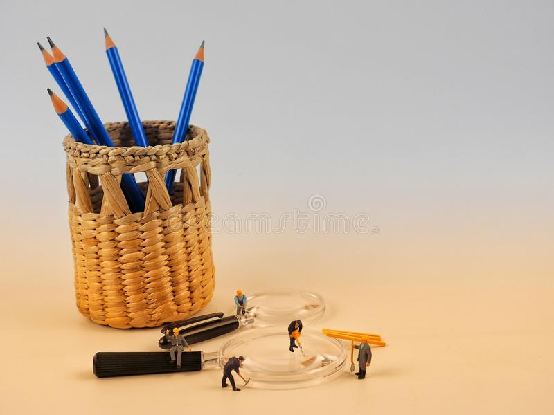 Miniature people engineer worker on white background. royalty free stock images