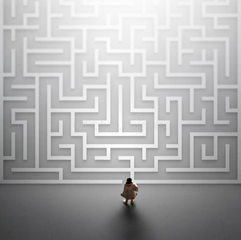 Miniature people entering a maze. Problems in Life concept. Miniature people entering a maze. Problems in Life concept royalty free stock photos
