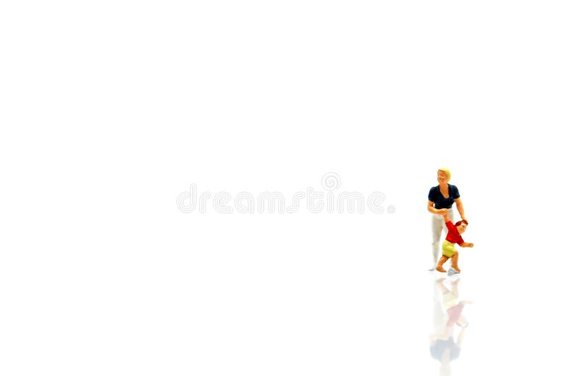 Miniature people : Family and children with house using for concept of step family day. stock photo
