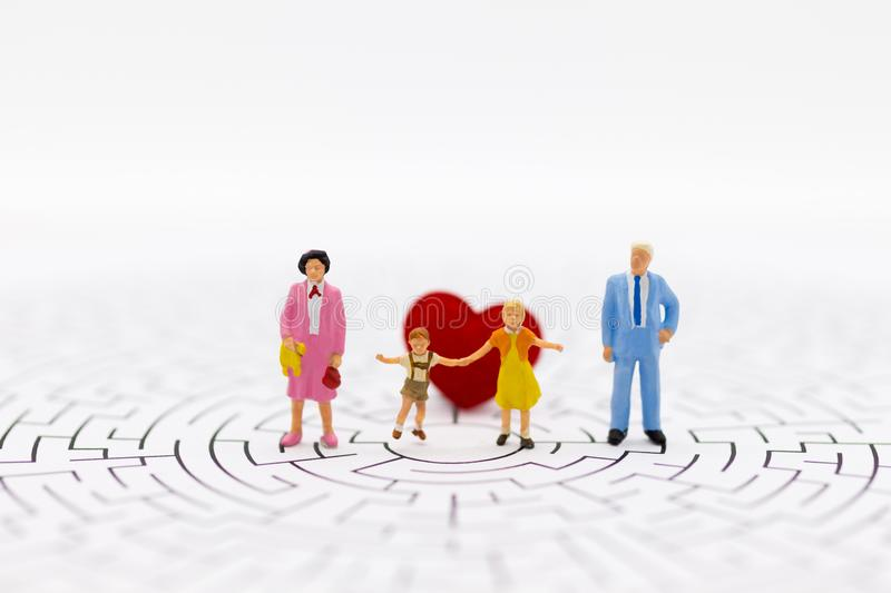 Miniature people: The family consists of parents and children. Image use for family day.  stock image