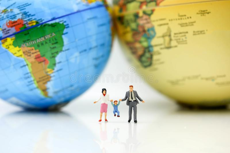 Miniature people family with mini world maptravel and family download miniature people family with mini world maptravel and family stock image gumiabroncs Gallery