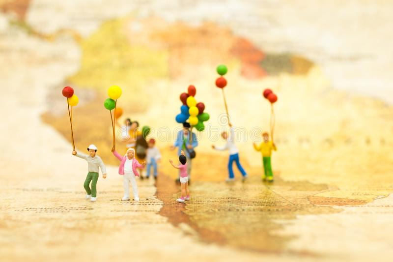 Miniature people: Family stand on map of world. Image use for background International day of families concept stock photos