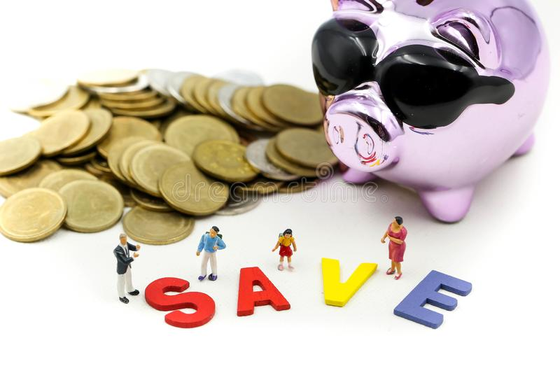 Miniature people : Family teach children saveing money coins with piggy bank,Teach your Children to save day.  royalty free stock images