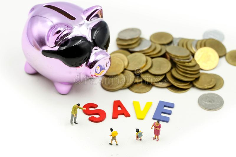 Miniature people : Family teach children saveing money coins with piggy bank,Teach your Children to save day.  stock images