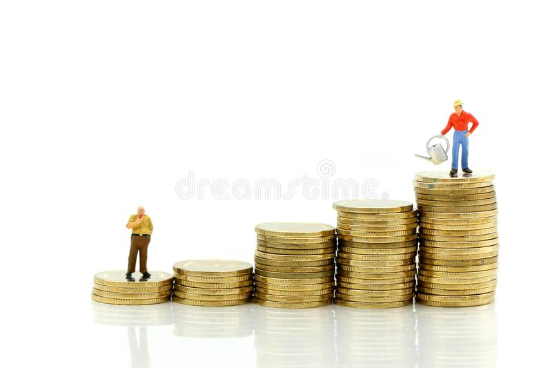 Miniature people : farmer stand on top of coins , Money, Financial, Business Growth concept. royalty free stock photos
