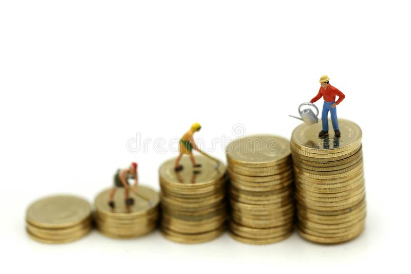 Miniature people : farmer stand on top of coins , Money, Financial, Business Growth concept. stock image