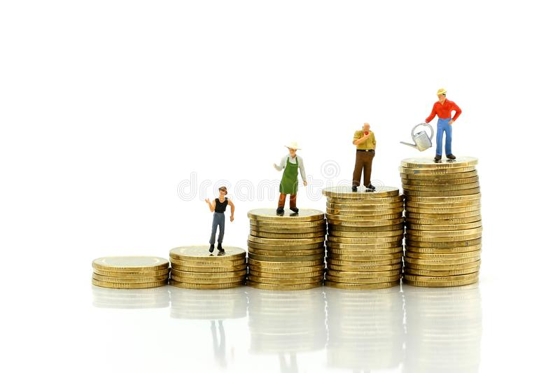 Miniature people : farmer stand on top of coins , Money, Financial, Business Growth concept. stock photos