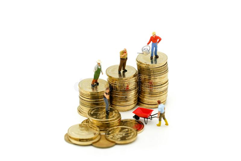 Miniature people : farmer stand on top of coins , Money, Financial, Business Growth concept. royalty free stock photography
