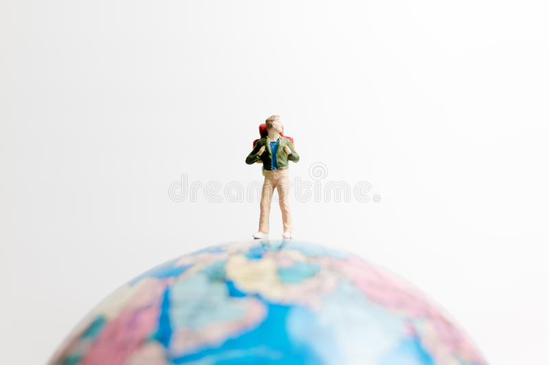 Miniature people figure standing on the globe world map. With white background and copy space as travel concept royalty free stock images
