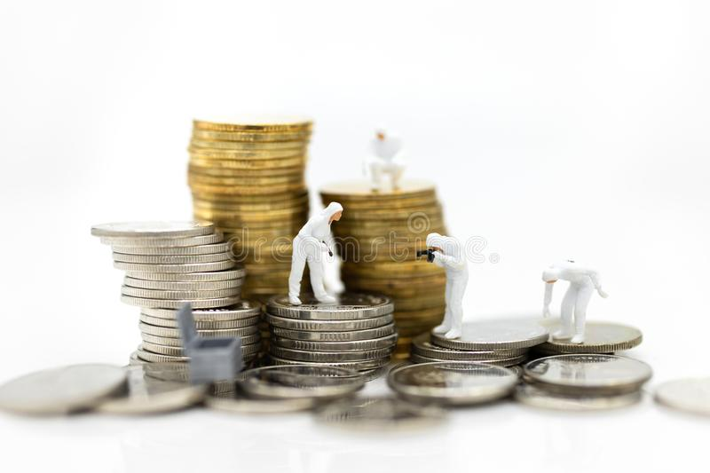 Miniature people: Financial auditors are investigating the source of revenue. Image use for financial, business concept.  stock photo