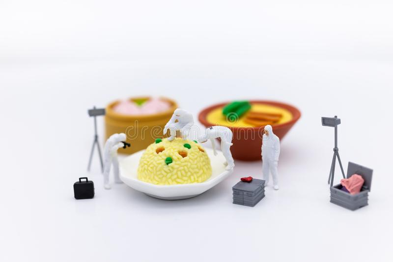 Miniature People and food, check the nutritional value, nutrients received in each meal. Image use for food and beverage concept.  royalty free stock images