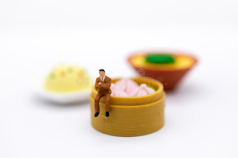 Miniature People and food, check the nutritional value, nutrients received in each meal. Image use for food and beverage concept.  stock photos