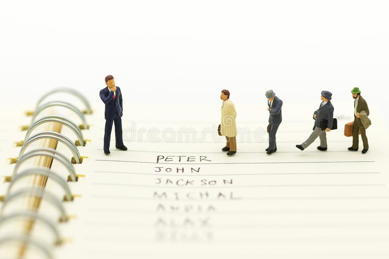 Miniature people, Group of businessmen work with team, using as background Choice of the best suited employee, stock images