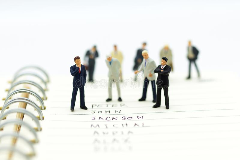 Miniature people, Group of businessmen work with team, royalty free stock image
