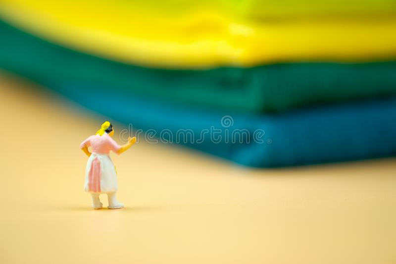 Miniature people : Housewives in hard to work in house. Concept of wife stock image