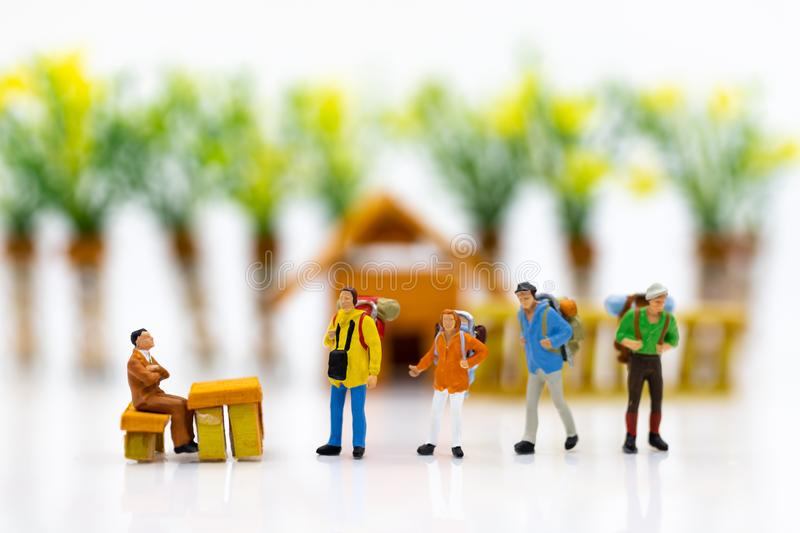 Miniature people : Immigration system for tourists when leaving the country. Image use for holiday travel, business concept royalty free stock images