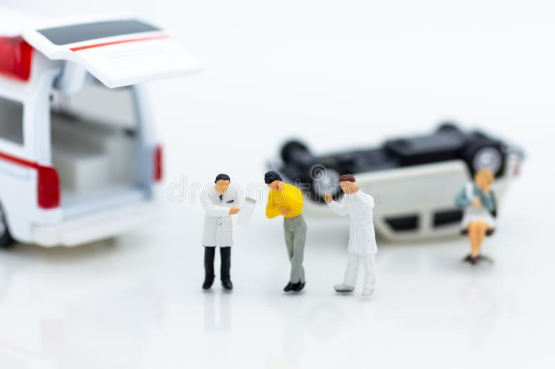 Miniature people : Injured personal from road accidents, ambulance transported to the hospital for treatment. Image use for not living on negligence stock photo