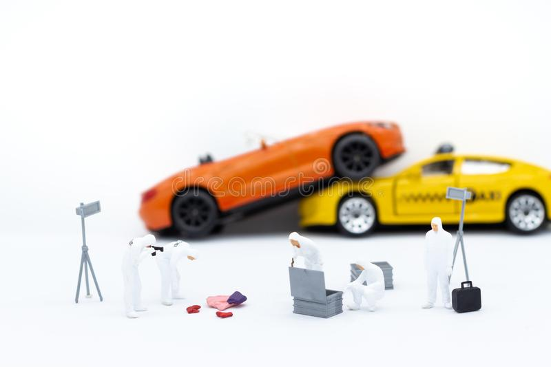 Miniature people: Inspection team looking for evidence of accident. Image use for Living with carelessness, danger on the road,. Carefully concept royalty free stock photos