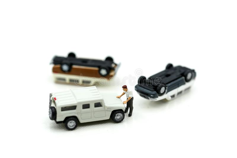 Miniature people : Insurance Agent examine Damaged Car and filing Report Claim Form after accident. stock image