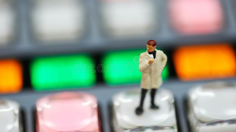 Miniature people : journalists , cameraman ,Videographer at work royalty free stock photography