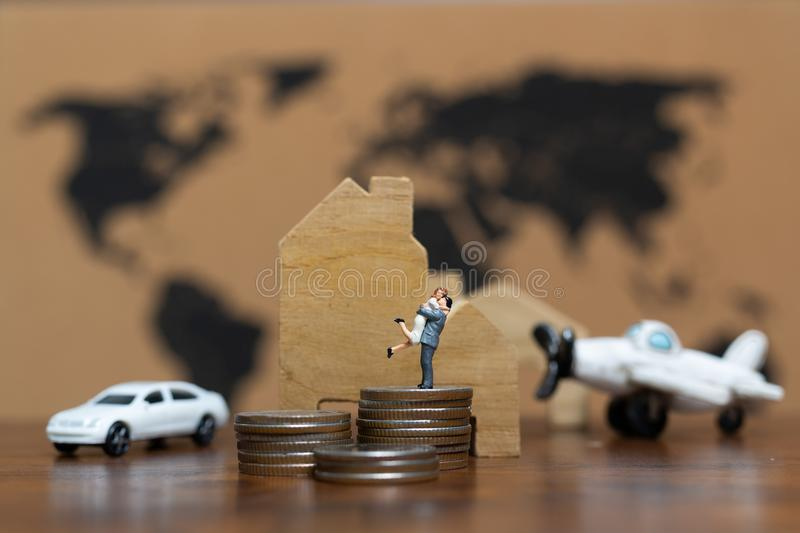 Miniature people : Luxury Lifestyle Couple with a lot of money , stock image