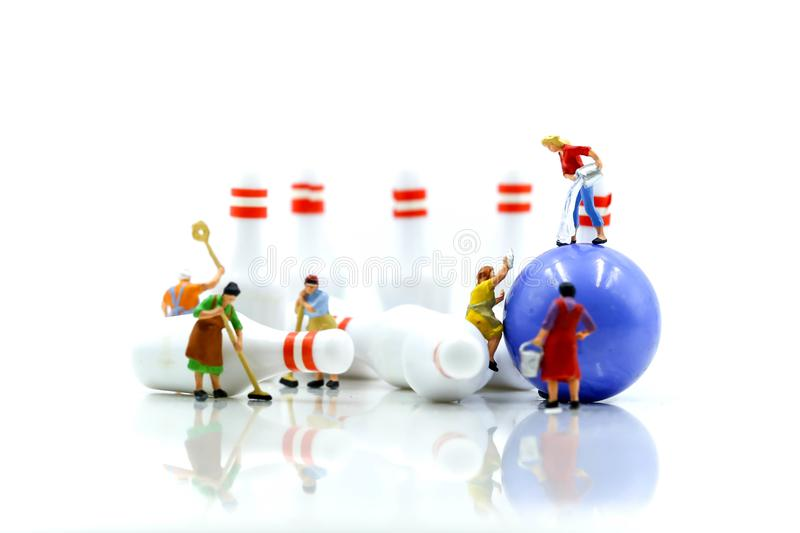 Miniature people : Maid or Housewife cleaning bowling pin and ba. Ll royalty free stock image