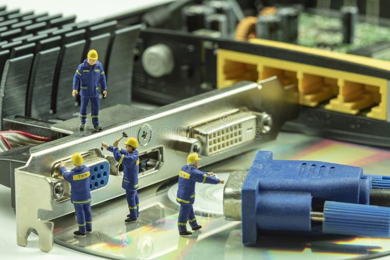 Miniature people maintenance electronic device component royalty free stock photography