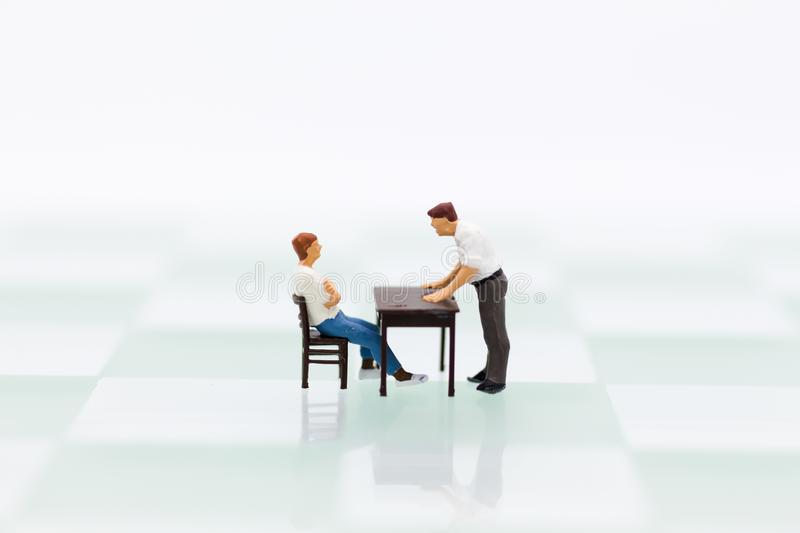 Miniature people : Men are being blamed for wrongdoing. Image use for admonition, reprimand, emotional expression stock image