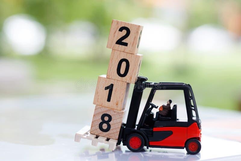 Miniature people move block number 2018. Miniature business people move block number 2018. business concept stock photos