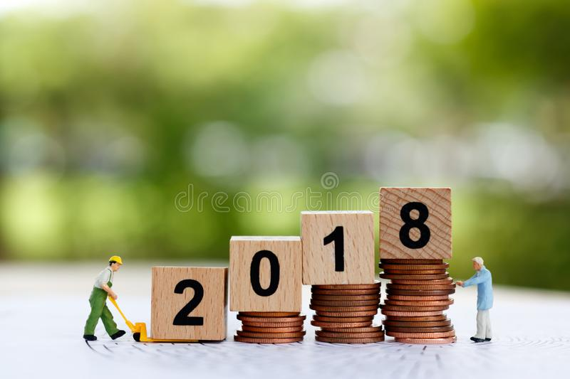 Miniature people move block number 2018. Business concept stock images