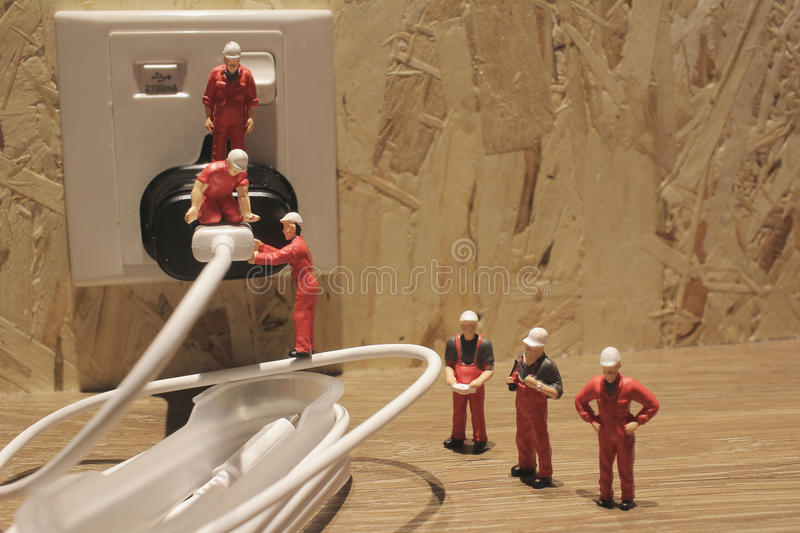 Miniature people Network Engineers At Work. The Miniature people Network Engineers At Work royalty free stock photos