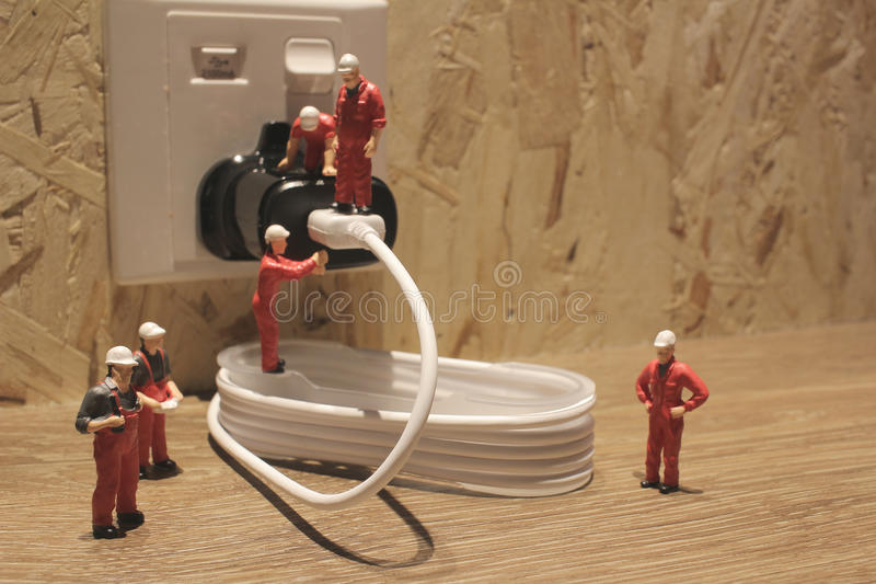 Miniature people Network Engineers At Work. The Miniature people Network Engineers At Work stock photography